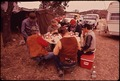 DEER HUNTERS DRINK AND PLAY POKER WHILE WAITING FOR WILD DEER. THE HUNTERS HAVE BUILT A PERMANENT CAMP TO WHICH THEY... - NARA - 546089.tif