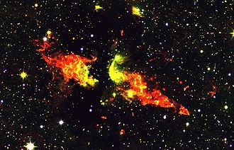 """Bipolar outflow - Infrared image of a bipolar outflow.  The outflow is driven by a massive young star that was first identified as a radio source and catalogued """"DR 21"""". The outflow itself is known as the DR21 outflow, or MHO 898/899. Image credit: Chris Davis, UKIRT/Joint Astronomy Centre"""