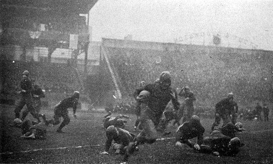 Pitt's Tom Davies runs against undefeated and unscored upon Georgia Tech in the 1918 game at Forbes Field. Pitt won the game 32-0 and is considered by many to be that season's national champion. DaviesPittGT1918.jpg