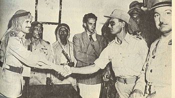 English: Moshe Dayan and Abdullah el Tell reac...