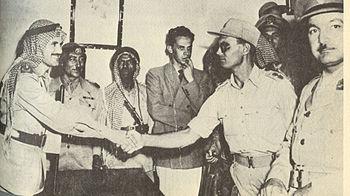 English: Moshe Dayan and Abdullah el Tell reac...
