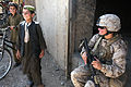 Defense.gov News Photo 100806-M-0301S-101 - U.S. Marine Cpl. Mary E. Walls right an ammunition technician with a female engagement team laughs with Afghan children during a patrol with 1st.jpg