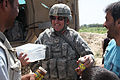 Defense.gov News Photo 100829-A-1182G-059 - U.S. Army Maj. Michael Gardner with a civil military support team gives jars of jam to residents in the village of Bahshekel in the Parwan.jpg