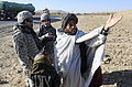 Defense.gov News Photo 101127-F-2185F-034 - U.S. Army 1st Lt. Raymond Gobberg 2nd from right the information operations officer for the Zabul Provincial Reconstruction Team talks with a.jpg