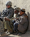 Defense.gov News Photo 101222-F-2185F-110 - U.S. Air Force Capt. Ryan Weld an intelligence officer with the Zabul Provincial Reconstruction Team talks with Afghans during a wroowali or.jpg