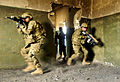 Defense.gov News Photo 110221-N-2142H-174 - U.S. Army soldiers serving as mentors for Afghan soldiers demonstrate how to secure a room during urban terrain training at Camp Zafar in.jpg