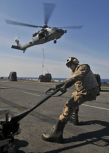 Defense.gov News Photo 110403-N-9950J-204 - Lance Cpl. Gordon Rogers moves supplies on the flight deck of the amphibious assault ship USS Essex LHD 2 during a vertical replenishment with the.jpg