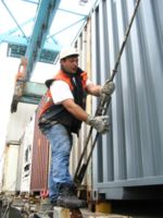 Dockworker lashing a container.jpg