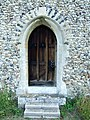 Door with sun dial above it at St. Mary's church. - geograph.org.uk - 472479.jpg