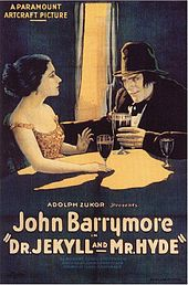 "Drawing of a white man and woman sitting at a table drinking wine. A beam of light illuminates them while the rest of the image is in shadow. Beneath them is text saying ""Adolph Zukor presents John Barrymore in Dr. Jekyll and Mr. Hyde"""