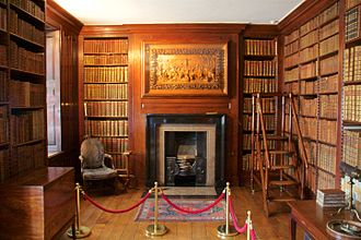 Dunham Massey Hall - The library, with the Grinling Gibbons carving