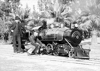 Eastlake Park Scenic Railway - John J. Coit at the tender and 'Shorty' Chase on the footplate (both with bowler hats) behind the fireman