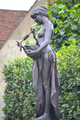 Edward Onslow Ford (1852-1901) - The Muse of Poetry (1891) left, Marlowe Memorial nr Marlowe Theatre, The Friars, Canterbury, UK, October 2012 (8111622455).png