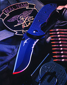 A black recurve bladed knife.