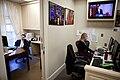 Eputy Press Secretary Josh Earnest and Press Assistant Caroline Hughes working, 2011.jpg
