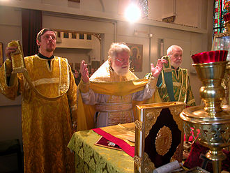 Entrance (liturgical) - Orthodox priest and deacons praying the Cherubic Hymn at the beginning of the Great Entrance.