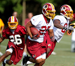 Evan Royster - Royster (center) at Redskins training camp in 2011.