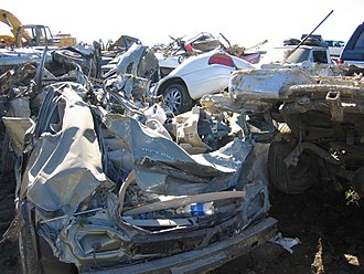 La Conchita, California - Damaged and destroyed vehicles line the side of the road in La Conchita. FEMA photo, 01-15-2005.