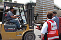 FEMA - 31967 - Fork lift driver unloads water at a Red Cross Distribution Center.jpg