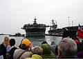 Family and friends watch as the amphibious assault ship USS Kearsarge (LHD 3), center, returns to Naval Station Norfolk, Va., Nov. 7, 2013, after completing an eight-month deployment 131107-N-QY430-035.jpg