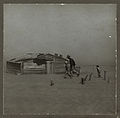 Farmer walking in dust storm Cimarron County Oklahoma.jpg