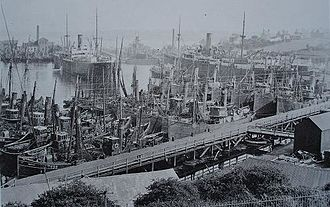 Milford Haven - Fishing fleet laid up in Milford docks during coal miners strike, along with troopships for transporting soldiers to Ireland,1921