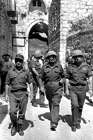 Reunification of Jerusalem - Chief of Staff Lt. Gen. Yitzhak Rabin in the entrance to the old city of Jerusalem during the Six Day War, with Moshe Dayan and Uzi Narkiss.