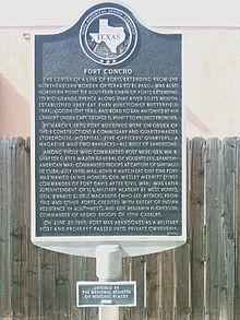 A Texas State Historical Association plaque describing the service history of Fort Concho in metal type: Underneath it is a smaller plaque marking the fort as a National Register of Historic Places property.