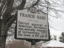 A Highway Historical Marker along a roadway detailing Nash's biography