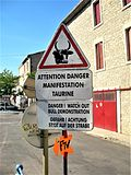 French, English and German, road sign in Saint Gilles, Camargue.jpg