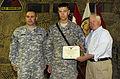 From right, Secretary of Defense Robert M. Gates presents U.S. Army Spec 100901-F-DQ383-008.jpg
