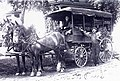 Fruit peddlers with draft horses and covered wagon, St. Paul (4418715023) (cropped).jpg