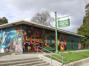 Garfield Square - Park's pool building, sign, and murals.
