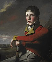 A young, rosy-cheeked man in the red uniform of the British Army.