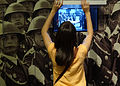 Girl Views Exhibit on East German Militarism - DDR Museum - Eastern Berlin - Germany.jpg