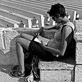 Girl reading (19679975372).jpg