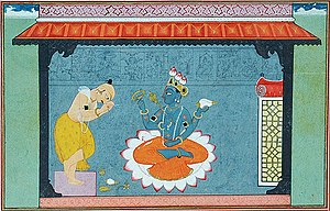 Closeup of Vishnu, seated in the lotus position on a lotus. From depiction of the poet Jayadeva bowing to Vishnu, Gouache on paper Pahari, The very picture of devotion, bare-bodied, head bowed, legs crossed and hands folded, Jayadeva stands at left, with the implements of worship placed before the lotus-seat of Vishnu who sits there, blessing the poet.