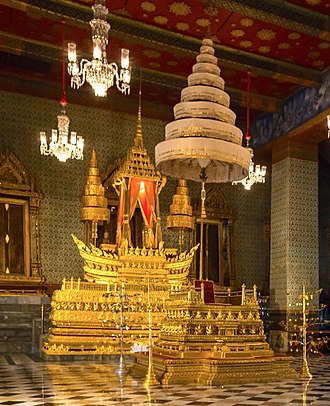 Coronation of the Thai monarch - The Royal Nine-Tiered Umbrella over the throne inside the Amarin Winitchai throne hall, Grand Palace. The umbrella is an ancient symbol of kingship dating back to ancient India.