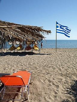 Greek flag on beach
