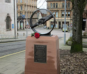 Radical War - Radical War monument in Greenock, across the street from the Jail site. The Dutch Gable building of 1755 is seen past the clasped hands, the Mid Kirk of 1761 is to the left.