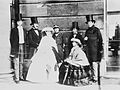 Group photograph of Queen Victoria, Prince Albert, Albert Edward, Prince of Wales, Count of Flanders, Princess Alice, Duke of Oporto, and King Leopold I of the Belgians, 1859.jpg