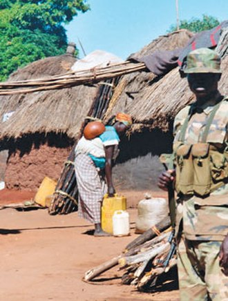 Military history of Uganda - A soldier in an internally displaced persons camp in northern Uganda in 2003. Northern Uganda saw a number of displaced civilians due to civil conflict in Uganda, as well as civil war in neighbouring Sudan.