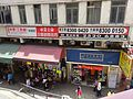 HK 西灣河 Sai Wan Ho 筲箕灣道 112-114 Shau Kei Wan Road old tang lau house corner building July 2016 Tai On Road Centaline tender sale sign sidewalk shops.jpg