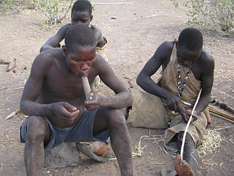 Recreational drug use - Hadzabe tribe members smoking.