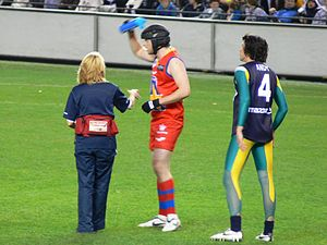 E. J. Whitten Legends Game - Hamish Blake (centre) and Andy Lee (right) were celebrity players in the 2008 match.