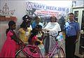 Handing over gifts to children of Valsalya Bhavan, Ponnurunni.jpg