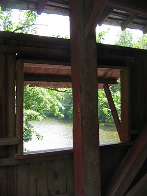 Hillsgrove Covered Bridge - Loyalsock Creek from the easternmost window on the south side, with a King post in front of the window (in 2008)