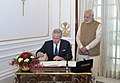 His Majesty The King Philippe of Belgium, signing the visitors' book, at Hyderabad House, in New Delhi on November 07, 2017. The Prime Minister, Shri Narendra Modi is also seen.jpg