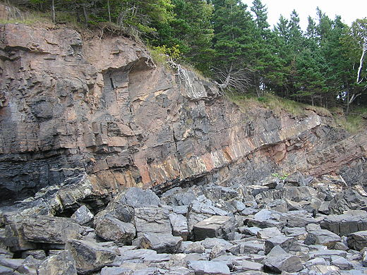 Mid-Carboniferous dolerite sill cutting Lower Carboniferous shales and sandstones, Horton Bluff, Minas Basin South Shore, Nova Scotia Horton Bluff mid-Carboniferous sill.JPG