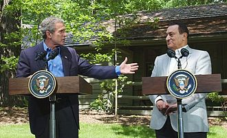 "Neoconservatism - During November 2010, former U.S. President George W. Bush (here with the former President of Egypt Hosni Mubarak at Camp David in 2002) wrote in his memoir Decision Points that Mubarak endorsed the administration's position that Iraq had WMDs before the war with the country, but kept it private for fear of ""inciting the Arab street"""
